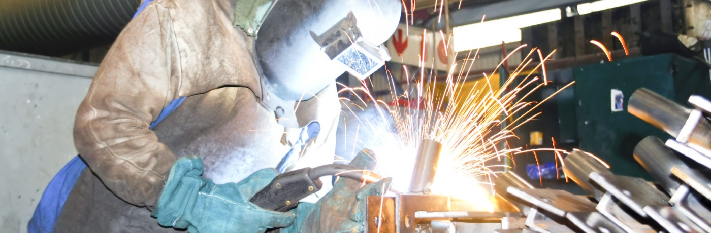 Factory worker welding metal
